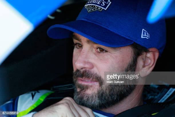 Jimmie Johnson driver of the Lowe's Chevrolet sits in his car during practice for the Monster Energy NASCAR Cup Series Toyota Owners 400 at Richmond...