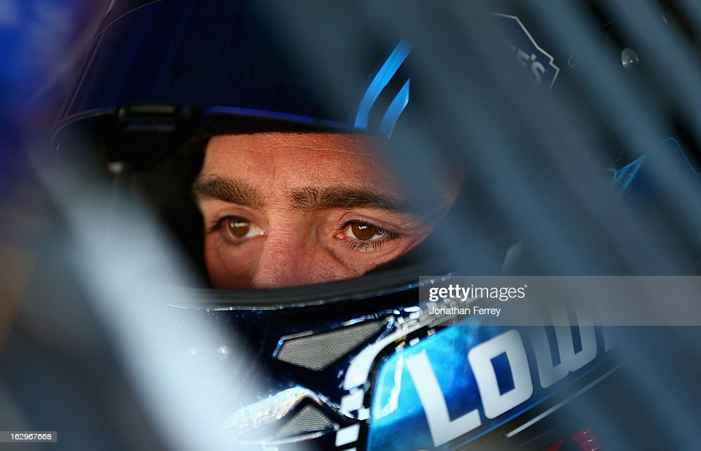 <a gi-track='captionPersonalityLinkClicked' href=/galleries/search?phrase=Jimmie+Johnson+-+Nascar+Race+Driver&family=editorial&specificpeople=171519 ng-click='$event.stopPropagation()'>Jimmie Johnson</a>, driver of the #48 Lowe's Chevrolet, sits in his car in the garage during practice for the NASCAR Sprint Cup Series Fresh Fit 500 at Phoenix International Raceway on March 2, 2013 in Avondale, Arizona.