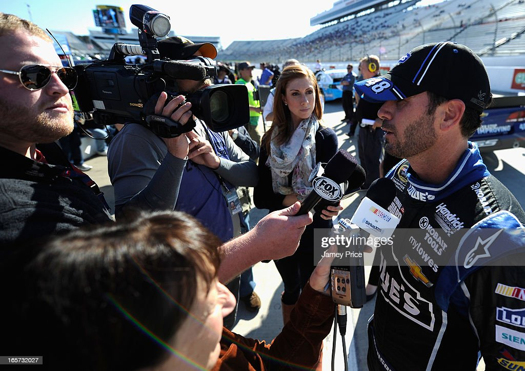 Jimmie Johnson, driver of the #48 Lowe's Chevrolet, speaks to the media after qulaifying for pole position for the NASCAR Sprint Cup Series STP Gas Booster 500 on April 5, 2013 at Martinsville Speedway in Ridgeway, Virginia.