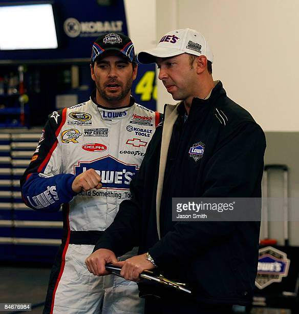 Jimmie Johnson driver of the Lowe's Chevrolet speaks with crew chief Chad Knaus during second practice for the Budweiser Shootout at Daytona...