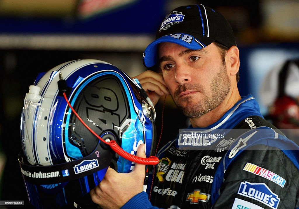 <a gi-track='captionPersonalityLinkClicked' href=/galleries/search?phrase=Jimmie+Johnson+-+Piloto+de+coches+de+carrera+de+Nascar&family=editorial&specificpeople=171519 ng-click='$event.stopPropagation()'>Jimmie Johnson</a>, driver of the #48 Lowe's Chevrolet, stands in the garage area during practice for the NASCAR Sprint Cup Series STP Gas Booster 500 on April 6, 2013 at Martinsville Speedway in Ridgeway, Virginia.