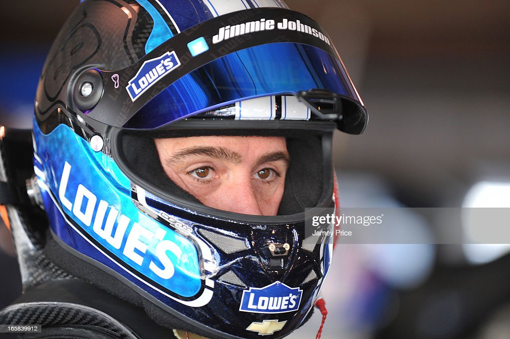 <a gi-track='captionPersonalityLinkClicked' href=/galleries/search?phrase=Jimmie+Johnson+-+Nascar-Pilot&family=editorial&specificpeople=171519 ng-click='$event.stopPropagation()'>Jimmie Johnson</a>, driver of the #48 Lowe's Chevrolet, stands in the garage area during practice for the NASCAR Sprint Cup Series STP Gas Booster 500 on April 6, 2013 at Martinsville Speedway in Ridgeway, Virginia.