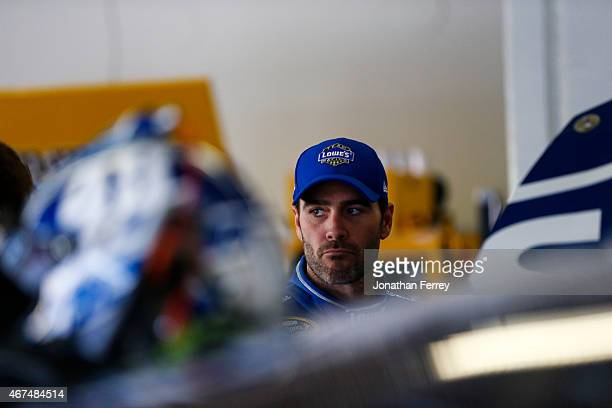 Jimmie Johnson driver of the Lowe's Chevrolet stands in the garage area during practice for the 57th Annual Daytona 500 at Daytona International...