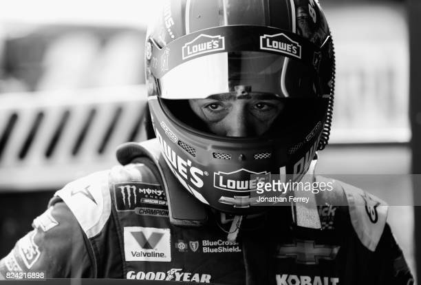 Jimmie Johnson driver of the Lowe's Chevrolet stands in the garage area during practice for the Monster Energy NASCAR Cup Series Overton's 400 at...