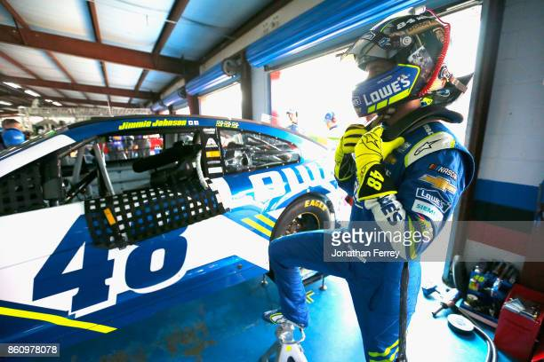 Jimmie Johnson driver of the Lowe's Chevrolet stands in the garage area during practice for the Monster Energy NASCAR Cup Series Alabama 500 at...