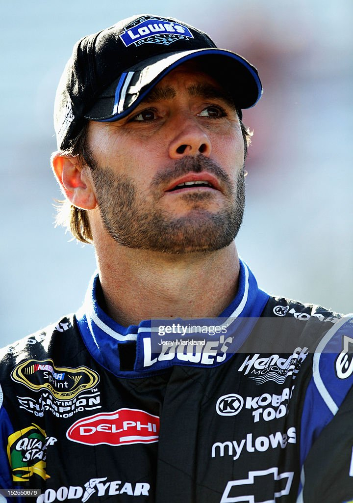 <a gi-track='captionPersonalityLinkClicked' href=/galleries/search?phrase=Jimmie+Johnson+-+Nascar+Race+Driver&family=editorial&specificpeople=171519 ng-click='$event.stopPropagation()'>Jimmie Johnson</a>, driver of the #48 Lowe's Chevrolet, stands on pit road during qualifying for the NASCAR Sprint Cup Series Sylvania 300 at New Hampshire Motor Speedway on September 21, 2012 in Loudon, New Hampshire.