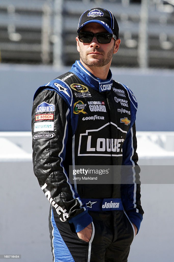 Jimmie Johnson, driver of the #48 Lowe's Chevrolet, stands on the grid during qualifying for the NASCAR Sprint Cup Series STP Gas Booster 500 on April 5, 2013 at Martinsville Speedway in Ridgeway, Virginia.