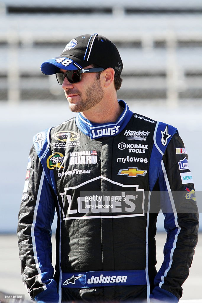 <a gi-track='captionPersonalityLinkClicked' href=/galleries/search?phrase=Jimmie+Johnson+-+Nascar+coureur&family=editorial&specificpeople=171519 ng-click='$event.stopPropagation()'>Jimmie Johnson</a>, driver of the #48 Lowe's Chevrolet, stands on the grid during qualifying for the NASCAR Sprint Cup Series STP Gas Booster 500 on April 5, 2013 at Martinsville Speedway in Ridgeway, Virginia.