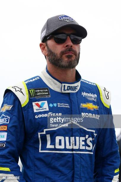 Jimmie Johnson driver of the Lowe's Chevrolet stands on the grid during qualifying for the Monster Energy NASCAR Cup Series Alabama 500 at Talladega...