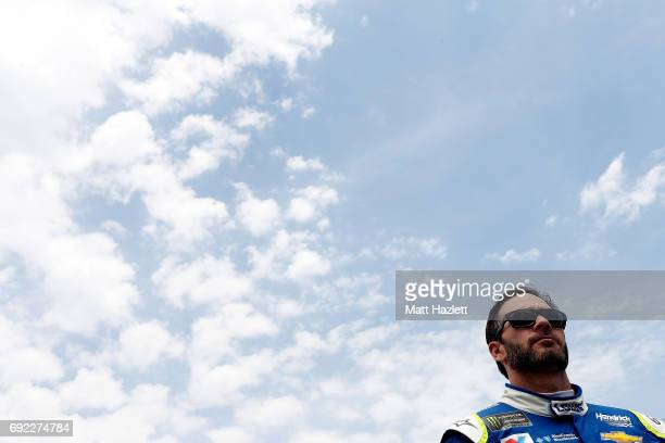 Jimmie Johnson driver of the Lowe's Chevrolet stands on the grid prior to the Monster Energy NASCAR Cup Series AAA 400 Drive for Autism at Dover...