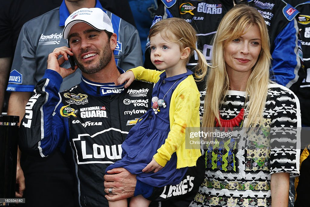 Jimmie Johnson, driver of the #48 Lowe's Chevrolet, stands with his wife Chandra Janway and daughter Genevieve Marie in victory lane after winning the NASCAR Sprint Cup Series Daytona 500 at Daytona International Speedway on February 24, 2013 in Daytona Beach, Florida.