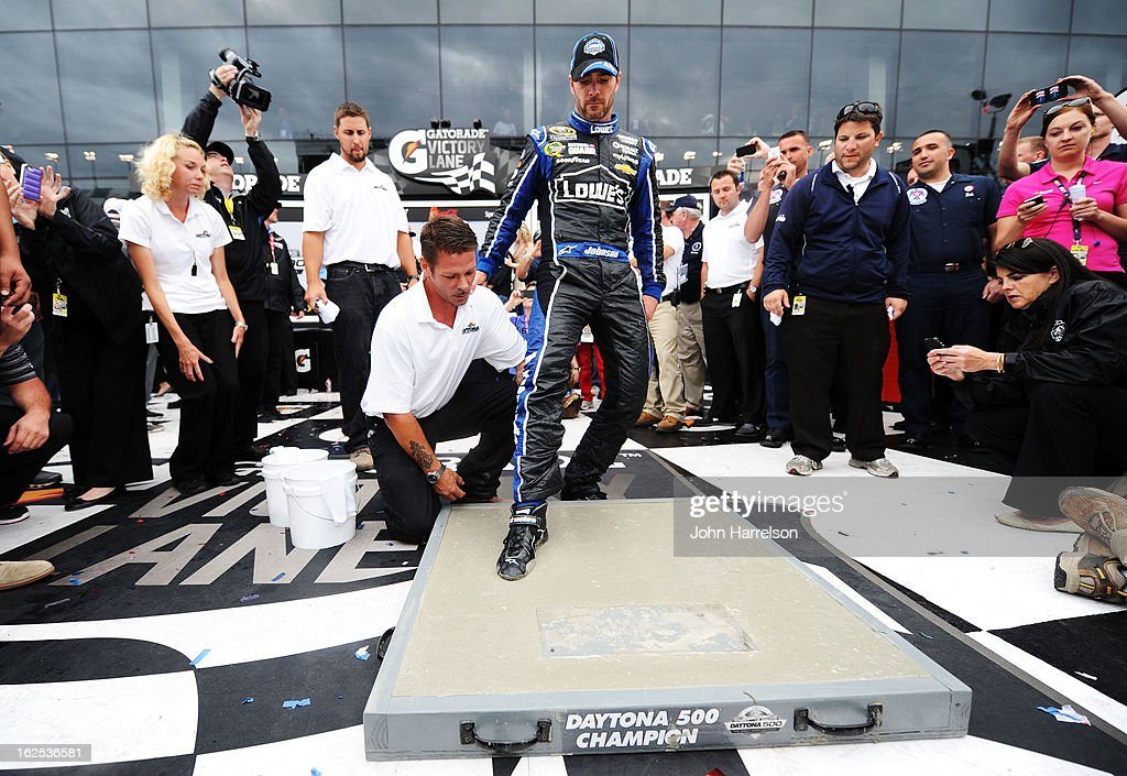 Jimmie Johnson, driver of the #48 Lowe's Chevrolet, steps into cement as he celebrates winning the NASCAR Sprint Cup Series Daytona 500 at Daytona International Speedway on February 24, 2013 in Daytona Beach, Florida.