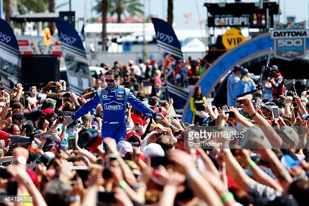 Jimmie Johnson driver of the Lowe's Chevrolet takes part in prerace ceremonies for the NASCAR Sprint Cup Series 57th Annual Daytona 500 at Daytona...
