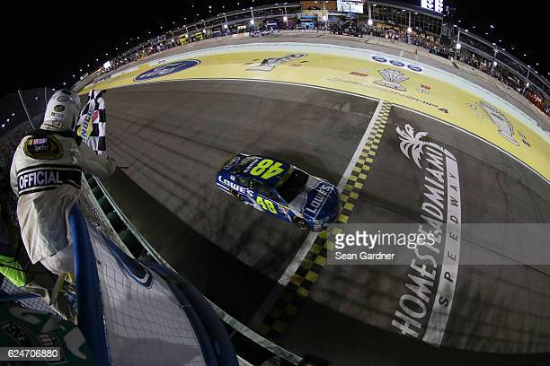 Jimmie Johnson driver of the Lowe's Chevrolet takes the checkered flag to win the NASCAR Sprint Cup Series Ford EcoBoost 400 and the 2016 NASCAR...