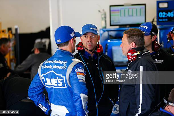 Jimmie Johnson driver of the Lowe's Chevrolet talks to crew chief Chad Knaus during practice for the 57th Annual Daytona 500 at Daytona International...