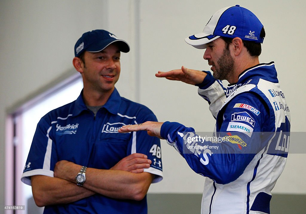 Jimmie Johnson, driver of the #48 Lowe's Chevrolet, talks to his crew chief Chad Knaus in the garage area during practice for the NASCAR Sprint Cup Series Daytona 500 at Daytona International Speedway on February 22, 2014 in Daytona Beach, Florida.
