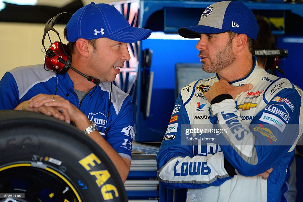 Jimmie Johnson, driver of the #48 Lowe's Chevrolet, talks with Chad Knaus during practice for the NASCAR Sprint Cup Series Go Bowling 400 at Kansas Speedway on May 6, 2016 in Kansas City, Kansas.
