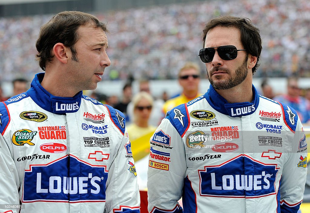 <a gi-track='captionPersonalityLinkClicked' href=/galleries/search?phrase=Jimmie+Johnson+-+Nascar+racerf%C3%B6rare&family=editorial&specificpeople=171519 ng-click='$event.stopPropagation()'>Jimmie Johnson</a> (R), driver of the #48 Lowe's Chevrolet, talks with crew chief <a gi-track='captionPersonalityLinkClicked' href=/galleries/search?phrase=Chad+Knaus&family=editorial&specificpeople=564401 ng-click='$event.stopPropagation()'>Chad Knaus</a> on the grid prior to the start of the NASCAR Sprint Cup Series LENOX Industrial Tools 301 at New Hampshire Motor Speedway on June 27, 2010 in Loudon, New Hampshire.
