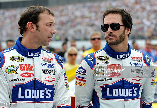 Jimmie Johnson driver of the Lowe's Chevrolet talks with crew chief Chad Knaus on the grid prior to the start of the NASCAR Sprint Cup Series LENOX...