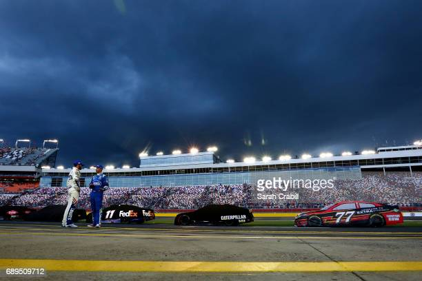 Jimmie Johnson driver of the Lowe's Chevrolet talks with his crew chief Chad Knaus during a weather delay during the Monster Energy NASCAR Cup Series...