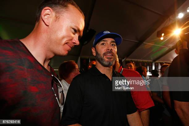 Jimmie Johnson driver of the Lowe's Chevrolet talks with Tour de France champion Chris Froome prior to the Monster Energy NASCAR Cup Series...