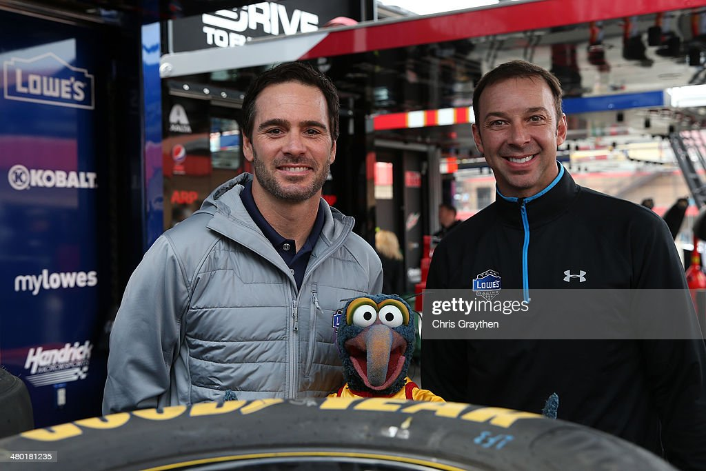 Jimmie Johnson, driver of the #48 Lowe's Chevrolet, The Great Gonzo, and Chad Knaus, crew chief of the #48 Lowe's Chevrolet, pose for a photo opportunity prior to the NASCAR Sprint Cup Series Auto Club 400 at Auto Club Speedway on March 23, 2014 in Fontana, California.