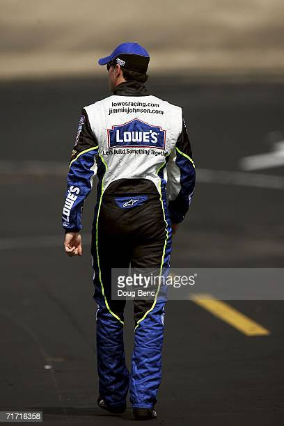 Jimmie Johnson driver of the Lowe's Chevrolet walks down pit road during practice for the NASCAR Nextel Cup Series Sharpie 500 on August 25 2006 at...