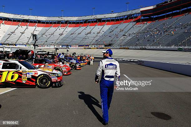 Jimmie Johnson driver of the Lowe's Chevrolet walks down pit road prior to practice for the NASCAR Sprint Cup Series Food City 500 at Bristol Motor...