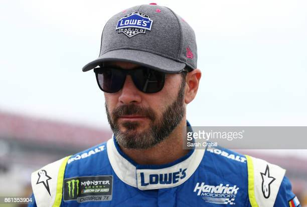 Jimmie Johnson driver of the Lowe's Chevrolet walks on the grid during qualifying for the Monster Energy NASCAR Cup Series Alabama 500 at Talladega...