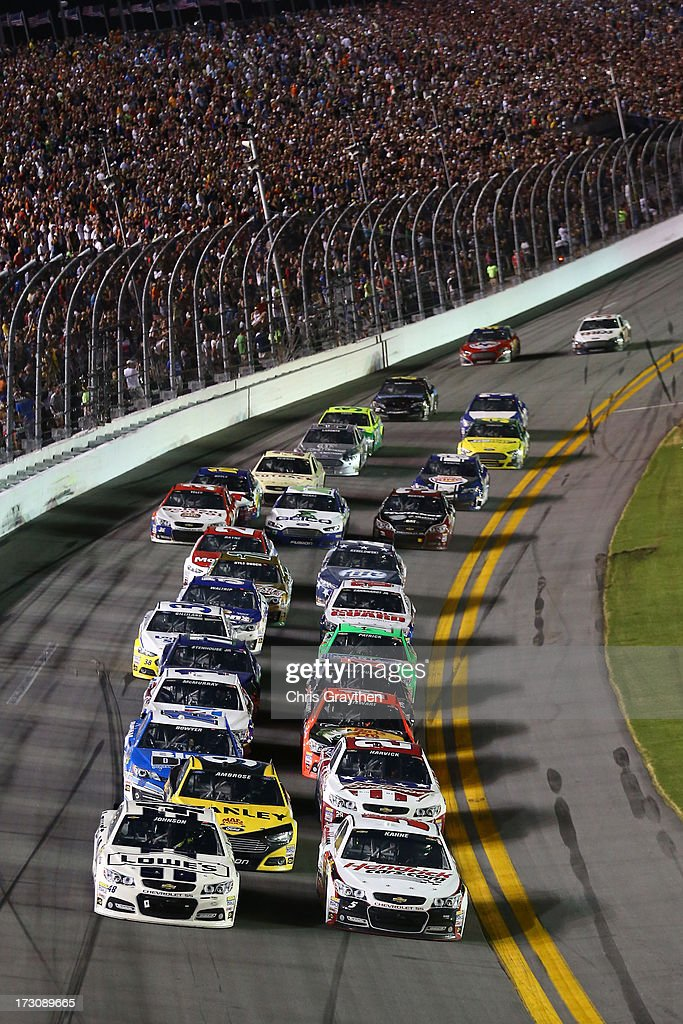 Jimmie Johnson, driver of the #48 Lowe's Dover White Chevrolet, and Kasey Kahne, driver of the #5 Hendrickcars.com Chevrolet, lead the field during the NASCAR Sprint Cup Series Coke Zero 400 at Daytona International Speedway on July 6, 2013 in Daytona Beach, Florida.