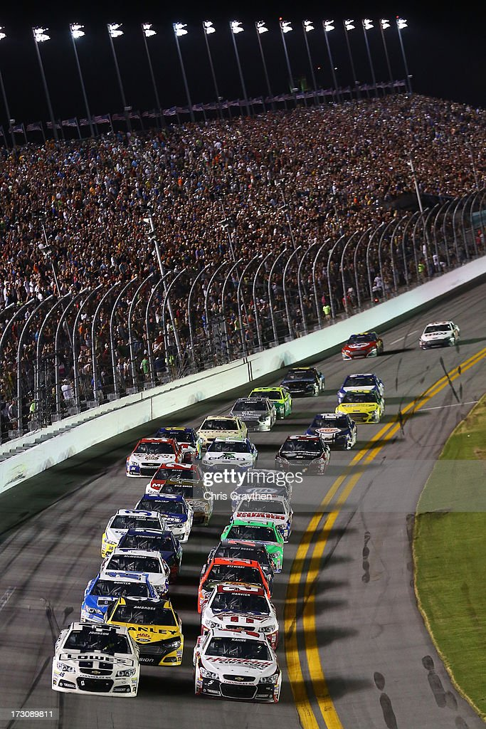 Jimmie Johnson, driver of the #48 Lowe's Dover White Chevrolet and Kasey Kahne, driver of the #5 Hendrickcars.com Chevrolet, lead the field on a restart during the NASCAR Sprint Cup Series Coke Zero 400 at Daytona International Speedway on July 6, 2013 in Daytona Beach, Florida.
