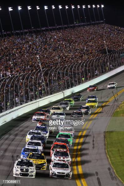 Jimmie Johnson driver of the Lowe's Dover White Chevrolet and Kasey Kahne driver of the Hendrickcarscom Chevrolet lead the field on a restart during...