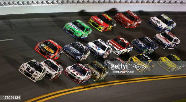 Jimmie Johnson driver of the Lowe's Dover White Chevrolet and Kasey Kahne driver of the Hendrickcarscom Chevrolet lead the field during the NASCAR...