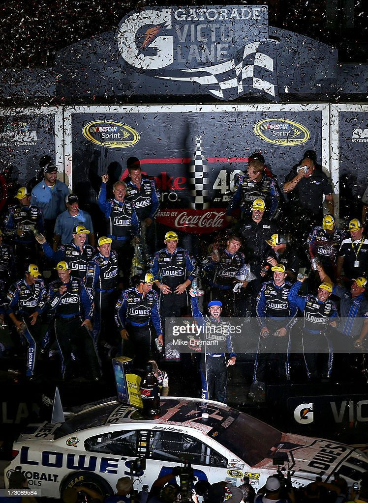 Jimmie Johnson, driver of the #48 Lowe's Dover White Chevrolet, celebrates with his crew in victory lane after winning the NASCAR Sprint Cup Series Coke Zero 400 at Daytona International Speedway on July 6, 2013 in Daytona Beach, Florida.