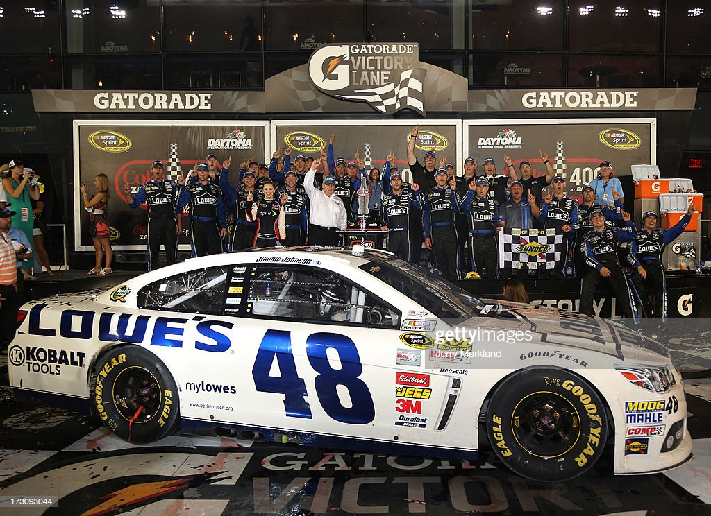 Jimmie Johnson, driver of the #48 Lowe's Dover White Chevrolet, celebrates with his team in victory lane after winning the NASCAR Sprint Cup Series Coke Zero 400 at Daytona International Speedway on July 6, 2013 in Daytona Beach, Florida.