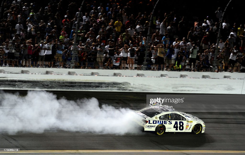 Jimmie Johnson, driver of the #48 Lowe's Dover White Chevrolet, does a burnout to celebrate winning the NASCAR Sprint Cup Series Coke Zero 400 at Daytona International Speedway on July 6, 2013 in Daytona Beach, Florida.