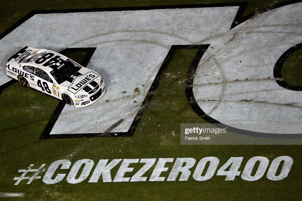 Jimmie Johnson, driver of the #48 Lowe's Dover White Chevrolet, drives through the infield to celebrate winning the NASCAR Sprint Cup Series Coke Zero 400 at Daytona International Speedway on July 6, 2013 in Daytona Beach, Florida.