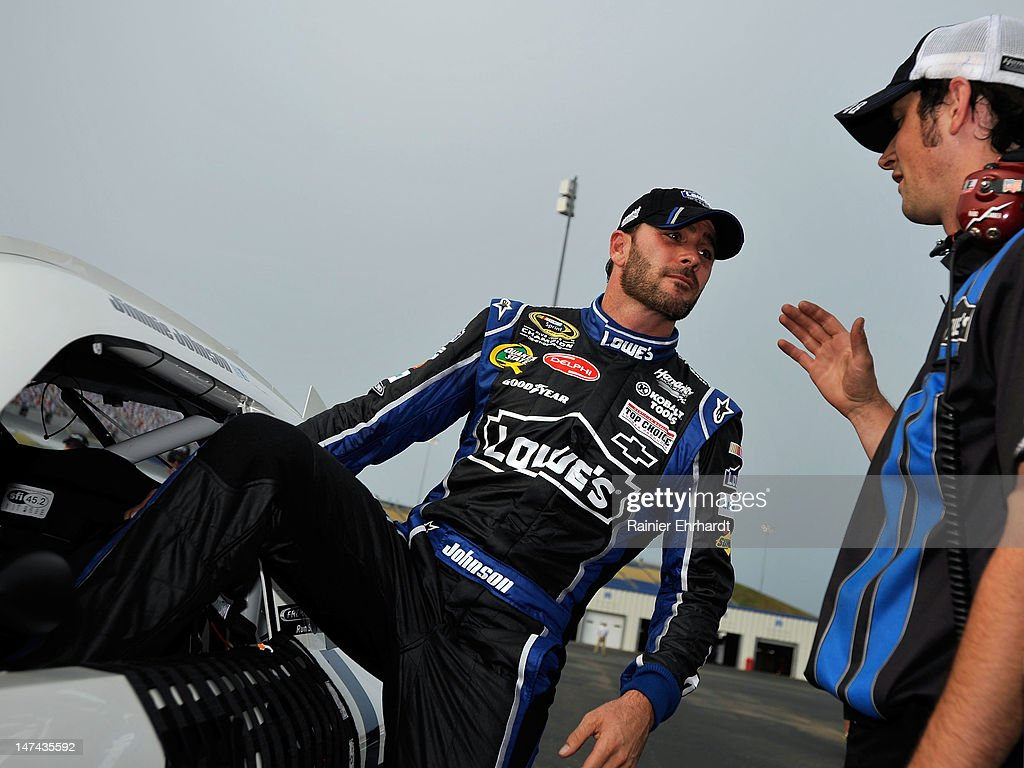 <a gi-track='captionPersonalityLinkClicked' href=/galleries/search?phrase=Jimmie+Johnson+-+Nascar+Race+Driver&family=editorial&specificpeople=171519 ng-click='$event.stopPropagation()'>Jimmie Johnson</a>, driver of the #48 Lowe's Dover White Chevrolet, is congratulated by a crew member after qualifying for pole position for the NASCAR Sprint Cup Series Quaker State 400 at Kentucky Speedway on June 29, 2012 in Sparta, Kentucky.