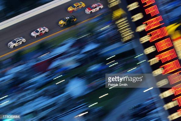 Jimmie Johnson driver of the Lowe's Dover White Chevrolet leads a pack of cars during the NASCAR Sprint Cup Series Coke Zero 400 at Daytona...