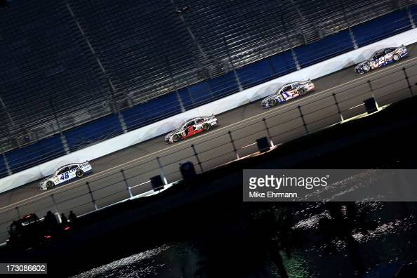 Jimmie Johnson driver of the Lowe's Dover White Chevrolet leads Kasey Kahne driver of the Hendrickcarscom Chevrolet Jamie McMurray driver of the...