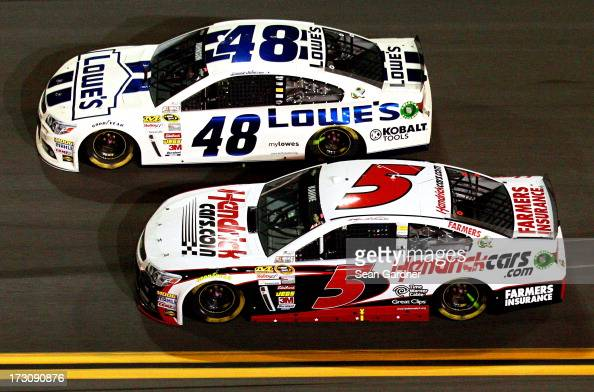 Jimmie Johnson driver of the Lowe's Dover White Chevrolet leads Kasey Kahne driver of the Hendrickcarscom Chevrolet during the NASCAR Sprint Cup...