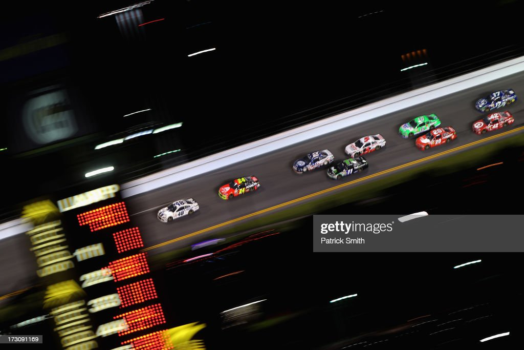 Jimmie Johnson, driver of the #48 Lowe's Dover White Chevrolet, leads the field during the NASCAR Sprint Cup Series Coke Zero 400 at Daytona International Speedway on July 6, 2013 in Daytona Beach, Florida.