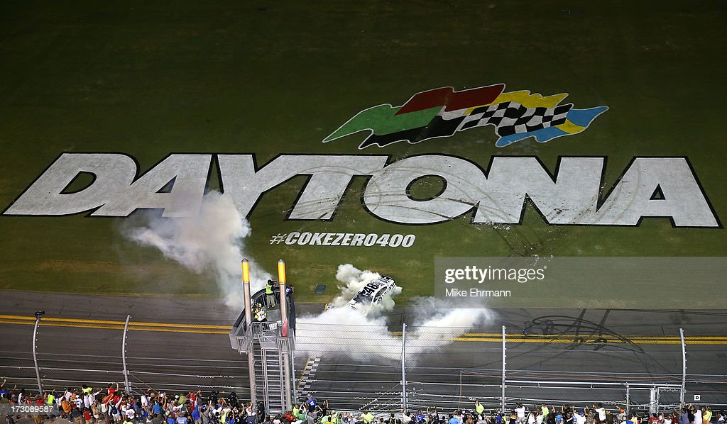 Jimmie Johnson, driver of the #48 Lowe's Dover White Chevrolet, performs a burnout in celebration of winning the NASCAR Sprint Cup Series Coke Zero 400 at Daytona International Speedway on July 6, 2013 in Daytona Beach, Florida.