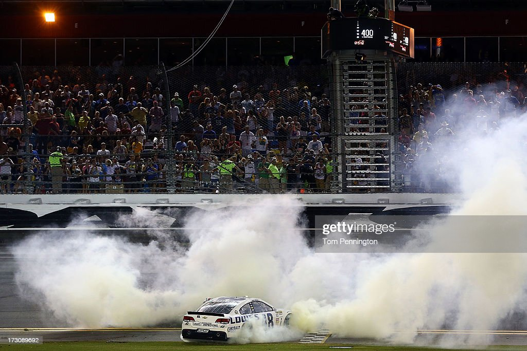 Jimmie Johnson, driver of the #48 Lowe's Dover White Chevrolet, performs a burout in celebration of winning the NASCAR Sprint Cup Series Coke Zero 400 at Daytona International Speedway on July 6, 2013 in Daytona Beach, Florida.