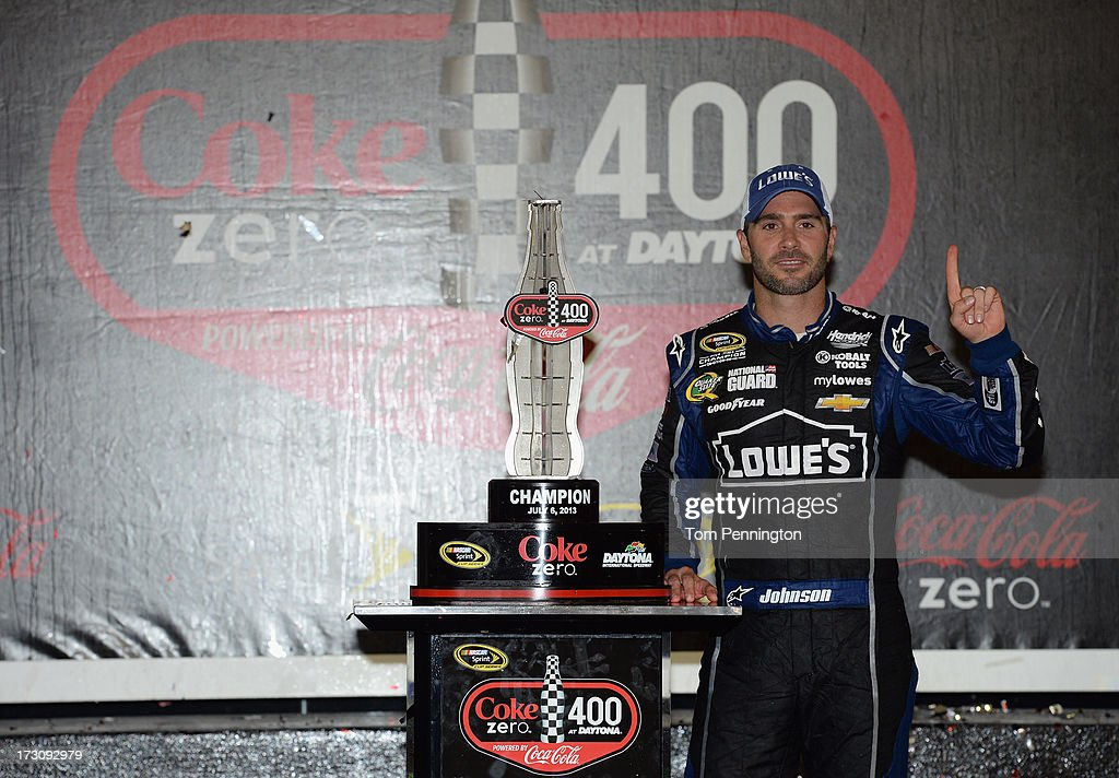 Jimmie Johnson, driver of the #48 Lowe's Dover White Chevrolet, poses in victory lane after winning the NASCAR Sprint Cup Series Coke Zero 400 at Daytona International Speedway on July 6, 2013 in Daytona Beach, Florida.