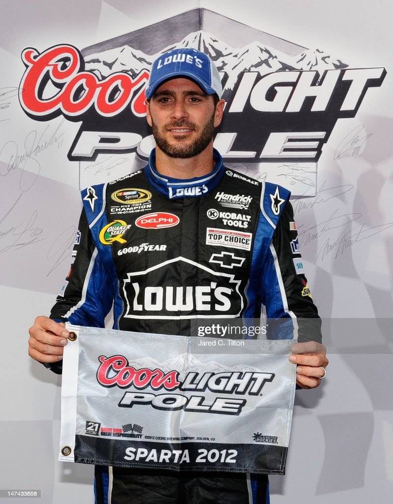 <a gi-track='captionPersonalityLinkClicked' href=/galleries/search?phrase=Jimmie+Johnson+-+Nascar+Race+Driver&family=editorial&specificpeople=171519 ng-click='$event.stopPropagation()'>Jimmie Johnson</a>, driver of the #48 Lowe's Dover White Chevrolet, poses with the Coors Light Pole Award after qualifying for pole position for the NASCAR Sprint Cup Series Quaker State 400 at Kentucky Speedway on June 29, 2012 in Sparta, Kentucky.