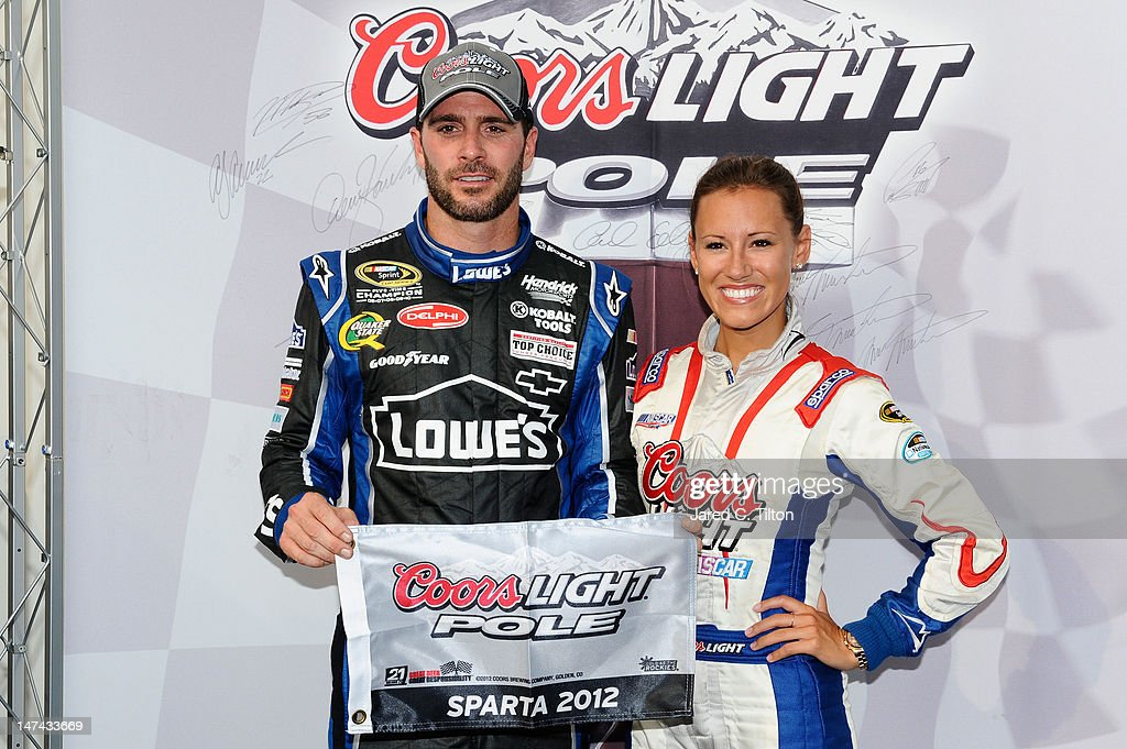 <a gi-track='captionPersonalityLinkClicked' href=/galleries/search?phrase=Jimmie+Johnson+-+Nascar+Race+Driver&family=editorial&specificpeople=171519 ng-click='$event.stopPropagation()'>Jimmie Johnson</a>, driver of the #48 Lowe's Dover White Chevrolet, poses with the Coors Light Pole Award and Miss Coors Light Rachael Rupert after qualifying for pole position for the NASCAR Sprint Cup Series Quaker State 400 at Kentucky Speedway on June 29, 2012 in Sparta, Kentucky.