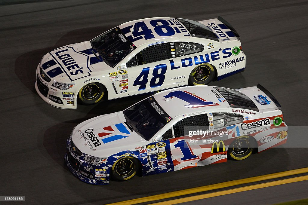 Jimmie Johnson, driver of the #48 Lowe's Dover White Chevrolet, races Jamie McMurray, driver of the #1 Cessna Chevrolet, during the NASCAR Sprint Cup Series Coke Zero 400 at Daytona International Speedway on July 6, 2013 in Daytona Beach, Florida.