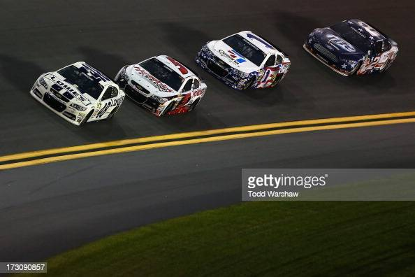 Jimmie Johnson driver of the Lowe's Dover White Chevrolet races Kasey Kahne driver of the Hendrickcarscom Chevrolet Jamie McMurray driver of the...