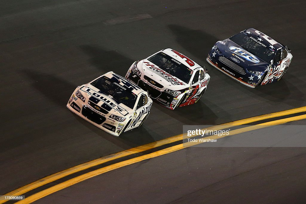 Jimmie Johnson, driver of the #48 Lowe's Dover White Chevrolet, races Kasey Kahne, driver of the #5 Hendrickcars.com Chevrolet, and Brad Keselowski, driver of the #2 Miller Lite Ford, during the NASCAR Sprint Cup Series Coke Zero 400 at Daytona International Speedway on July 6, 2013 in Daytona Beach, Florida.